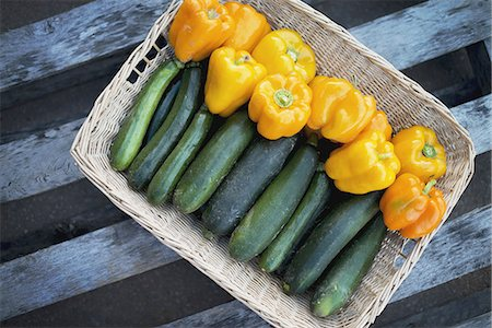 Organic Zucchini in basket with Yellow and Orange Bell Peppers Stock Photo - Premium Royalty-Free, Code: 6118-07352937
