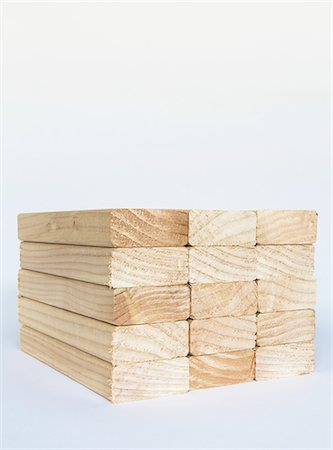 Stack of sawn prepared timber, spruce wood planks or studs, for use. Treated wood in traditional 2 by 4 measured cut shapes. Cut ends. Stock Photo - Premium Royalty-Free, Code: 6118-07353287