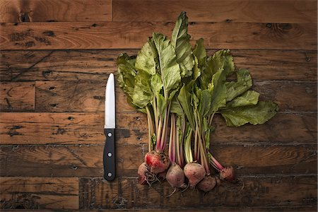 fabric - A handful of small beets, fresh organic vegetables harvested for the table. A vegetable knife. Stock Photo - Premium Royalty-Free, Code: 6118-07353435