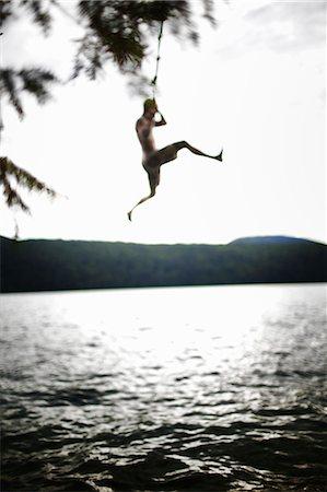swing (sports) - Boy jumping off rope swing Stock Photo - Premium Royalty-Free, Code: 6118-07353539