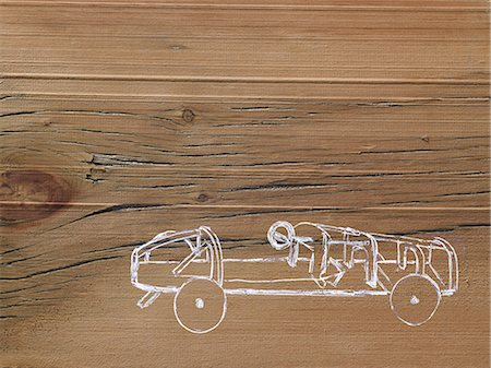 shape - A line drawing image on a natural wood grain background. Side profile of a low sporty open top car chassis. Stock Photo - Premium Royalty-Free, Code: 6118-07354001