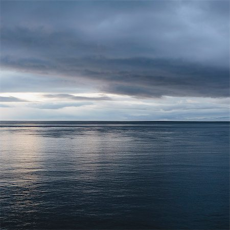 sky - The sea and sky over Puget Sound in Washington, USA. The horizon with light cloud layers above. Stock Photo - Premium Royalty-Free, Code: 6118-07354304