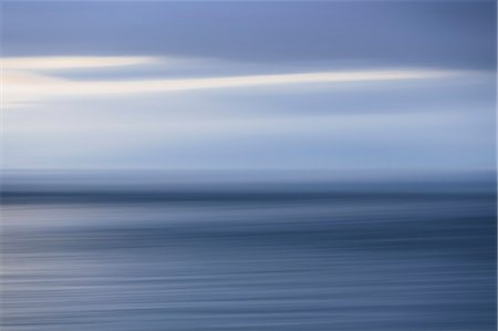 The sea and sky over Puget Sound in Washington, USA. The horizon with light cloud layers above. Stock Photo - Premium Royalty-Free, Code: 6118-07354306