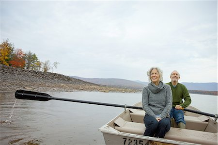 fitness   mature woman - A couple, man and woman sitting in a rowing boat on the water on an autumn day. Stock Photo - Premium Royalty-Free, Code: 6118-07440263