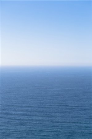sky - A view over the Pacific Ocean and a calm sea, merging into the blue sky. Stock Photo - Premium Royalty-Free, Code: 6118-07440232