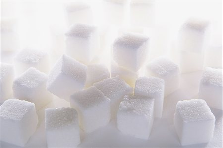 sugar - Sugar cubes on white backdrop Stock Photo - Premium Royalty-Free, Code: 6118-07440375