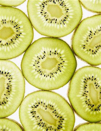 Organic kiwi slices, white background Stock Photo - Premium Royalty-Free, Code: 6118-07440571