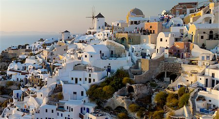 santorini island - The windmills of Santorini in Greece. A hilltop town of whitewashed houses. Sunset. Stock Photo - Premium Royalty-Free, Code: 6118-07440521