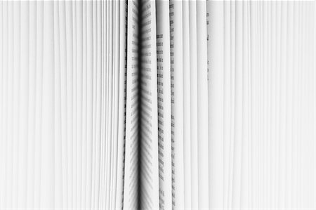 page - Close up of a book with the pages slightly fanned out, with a black paper edge in the centre. Stock Photo - Premium Royalty-Free, Code: 6118-07440694