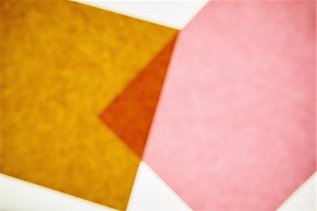 rectangle - Two pieces of recycled construction paper,  brown and pink with a small overlapping triangle. Stock Photo - Premium Royalty-Free, Code: 6118-07440705