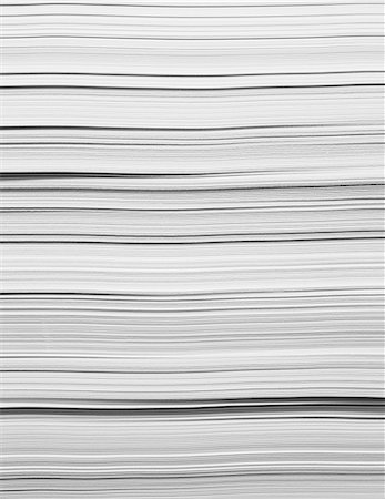A stack of recycled white paper, paper supplies. The paper edges. Stock Photo - Premium Royalty-Free, Code: 6118-07440726