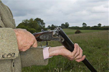 Man holding an open rifle. Stock Photo - Premium Royalty-Free, Code: 6118-07521766