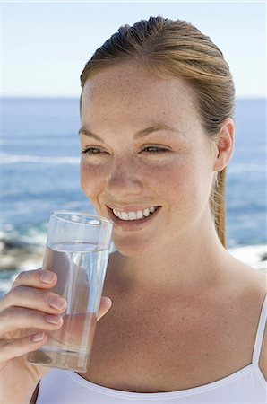 drinking water glass - A spa treatment centre. A young woman drinking a glass of water. Stock Photo - Premium Royalty-Free, Code: 6118-07521811
