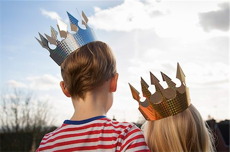 Two children in fancy dress, wearing crowns. Stock Photo - Premium Royalty-Free, Code: 6118-07731703