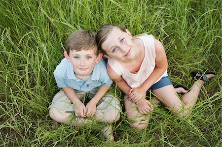 sister - Brother and sister sitting side by side, in long grass. Stock Photo - Premium Royalty-Free, Code: 6118-07731971