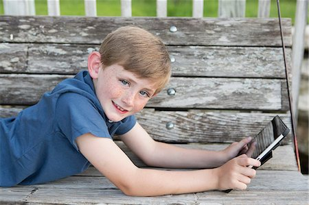 A young boy outdoors. Stock Photo - Premium Royalty-Free, Code: 6118-07732042