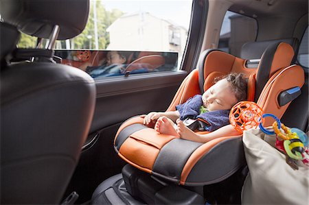 A mother and her young baby boy in a car. Stock Photo - Premium Royalty-Free, Code: 6118-07808991