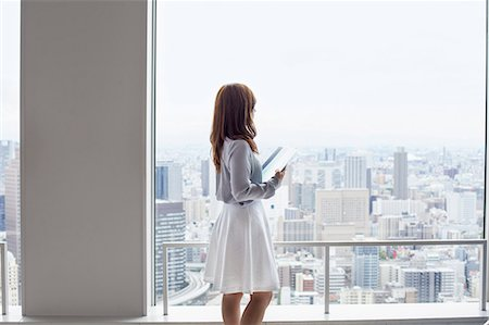 A working woman in an office building. Stock Photo - Premium Royalty-Free, Code: 6118-07813220