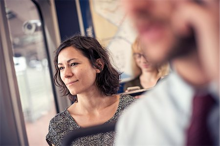 A woman on a busy bus looking out of the window Stock Photo - Premium Royalty-Free, Code: 6118-08243850