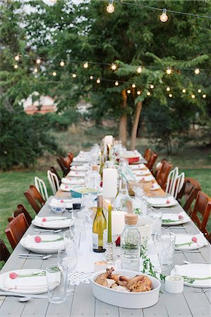 decoration - Long table set with plates and glasses, food and drink in a garden. Stock Photo - Premium Royalty-Free, Code: 6118-08282233