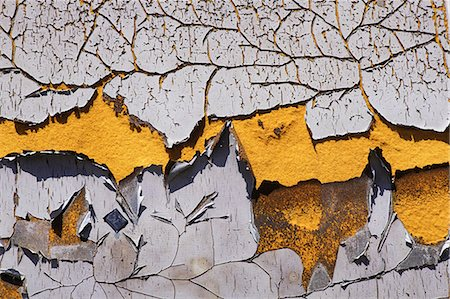 paint - Detail of peeling and cracked paint on an old silo wall. Stock Photo - Premium Royalty-Free, Code: 6118-08399650