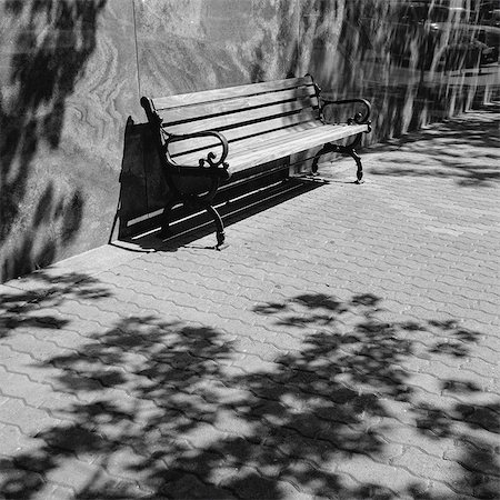 shadow - A bench on a downtown sidewalk in a town. Stock Photo - Premium Royalty-Free, Code: 6118-08399625