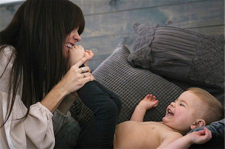 A woman playing with her young son. Stock Photo - Premium Royalty-Free, Code: 6118-08659784