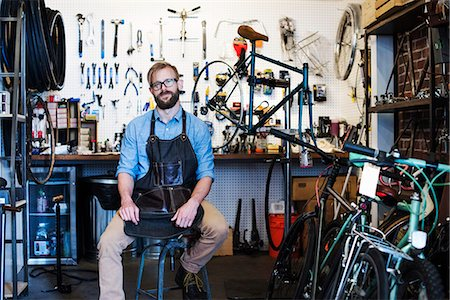 southern california - A man working in a bicycle repair shop. Stock Photo - Premium Royalty-Free, Code: 6118-08725690