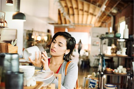 southern california - Young woman in a shop, looking at a ceramic jug. Stock Photo - Premium Royalty-Free, Code: 6118-08725732