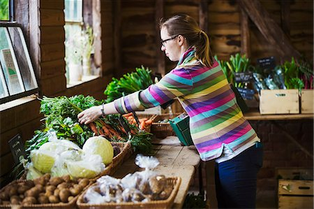 small business - A woman handling produce in a farm shop. Stock Photo - Premium Royalty-Free, Code: 6118-08729246
