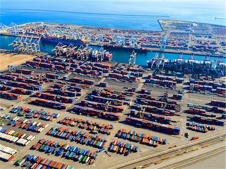 southern california - Aerial view of the container port at San Pedro in Los Angeles, with ships docked and containers awaiting loading. A commercial freight dockyard. Stock Photo - Premium Royalty-Free, Code: 6118-08827529