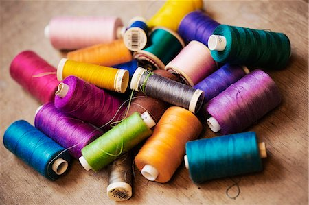 Bobbins of wound thread, silks and cottons in bright colours. Stock Photo - Premium Royalty-Free, Code: 6118-08910345