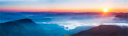 scenic - Adams Peak (Sri Pada) view at sunrise, mountains and the Maussakele Reservoir, Central Highlands, Sri Lanka, Asia Stock Photo - Premium Royalty-Free, Code: 6119-07451190