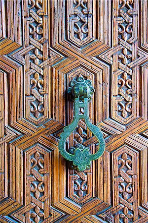 framed (photographic border showing) - Detail of a wooden door and bronze knocker, Islamo-Andalucian art, Marrakech Museum, Marrakech, Morocco, North Africa, Africa Stock Photo - Premium Royalty-Free, Code: 6119-07452244