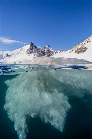 Above and below view of glacial ice in Orne Harbor, Antarctica, Polar Regions Stock Photo - Premium Royalty-Free, Code: 6119-07734923