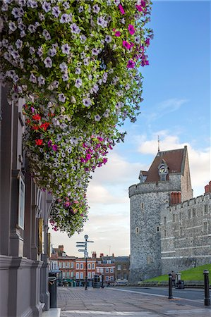 Hanging flowers in Windsor high street with Windsor Castle in the background, Windsor, Berkshire, England, United Kingdom, Europe Stock Photo - Premium Royalty-Free, Code: 6119-07845348