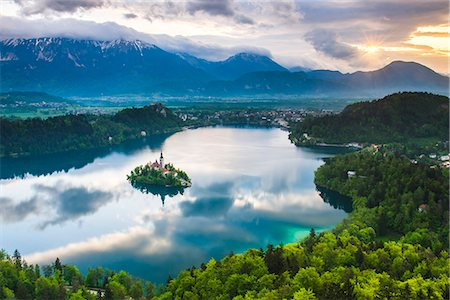 Lake Bled Island and the Julian Alps at sunrise, seen from Osojnica Hill, Bled, Julian Alps, Gorenjska, Slovenia, Europe Stock Photo - Premium Royalty-Free, Code: 6119-07845406