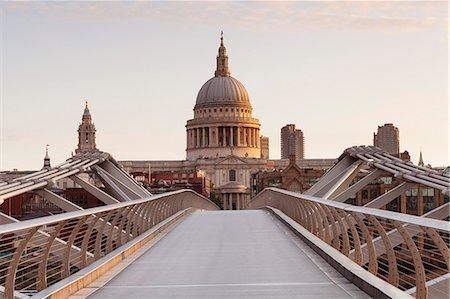 Millennium Bridge and St .Paul's Cathedral at sunrise, London, England, United Kingdom, Europe Stock Photo - Premium Royalty-Free, Code: 6119-07845508