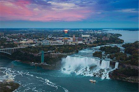 View of Rainbow Bridge and The American Falls, Niagara Falls, Niagara, border of New York State, and Ontario Canada, North America Stock Photo - Premium Royalty-Free, Code: 6119-07943548