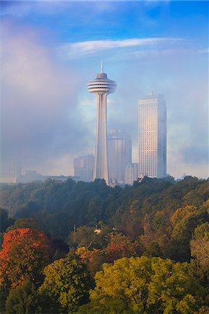 Mist from Horseshoe Falls swirling in front of Skylon Tower at dawn, Niagara Falls, Niagara, Ontario, Canada, North America Stock Photo - Premium Royalty-Free, Code: 6119-07943551