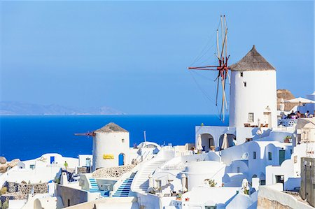 Windmill and traditional houses, Oia, Santorini (Thira), Cyclades Islands, Aegean Sea, Greek Islands, Greece, Europe Stock Photo - Premium Royalty-Free, Code: 6119-07943843