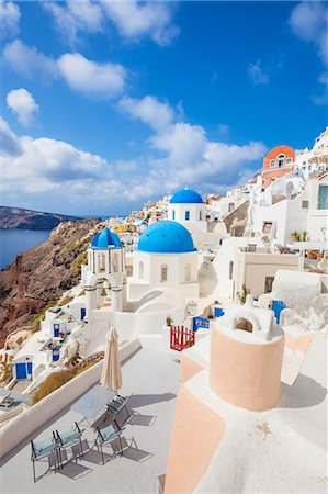 santorini - Greek church with three blue domes in the village of Oia, Santorini (Thira), Cyclades Islands, Greek Islands, Greece, Europe Stock Photo - Premium Royalty-Free, Code: 6119-07943844