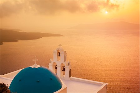 Blue dome and bell tower at sunset, St. Gerasimos church and Aegean Sea, Firostefani, Fira, Santorini (Thira), Cyclades Islands, Greek Islands, Greece, Europe Stock Photo - Premium Royalty-Free, Code: 6119-07943845