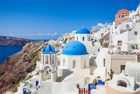 Greek church with three blue domes in the village of Oia, Santorini (Thira), Cyclades Islands, Greek Islands, Greece, Europe Stock Photo - Premium Royalty-Free, Code: 6119-07943839