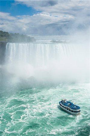Tourist boat in the mist of the Horseshoe Falls, or Canadian Falls, Niagara Falls, Ontario, Canada Stock Photo - Premium Royalty-Free, Code: 6119-07969010
