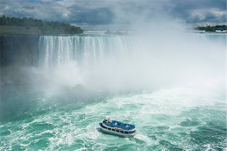 Tourist boat in the mist of the Horseshoe Falls (Canadian Falls), Niagara Falls, Ontario, Canada, North America Stock Photo - Premium Royalty-Free, Code: 6119-07969011