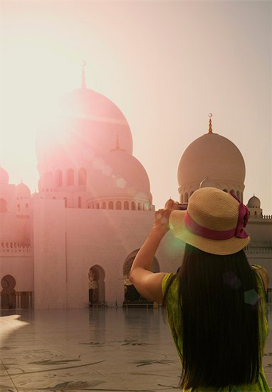 Woman photographing Sheikh Zayed Grand Mosque, Abu Dhabi, United Arab Emirates, Middle East Stock Photo - Premium Royalty-Free, Image code: 6119-08062282