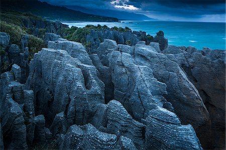 extreme terrain - Punakaiki, Pancake Rocks, West coast, North Island, New Zealand, Pacific Stock Photo - Premium Royalty-Free, Code: 6119-08351263