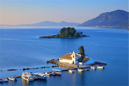 Elevated view to Vlacherna Monastery and the Church of Pantokrator on Mouse Island, Kanoni, Corfu, The Ionian Islands, Greek Islands, Greece, Europe Stock Photo - Premium Royalty-Free, Code: 6119-08420384