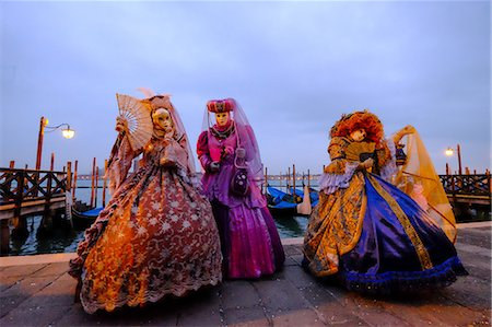 Masks and costumes at St. Mark's Square during Venice Carnival, Venice, Veneto, Italy, Europe Stock Photo - Premium Royalty-Free, Code: 6119-08420477